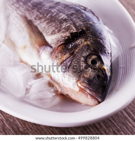 Fish over a white plate, horizontal image