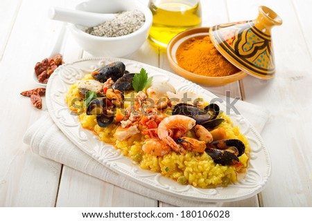 fish paella  - stock photo