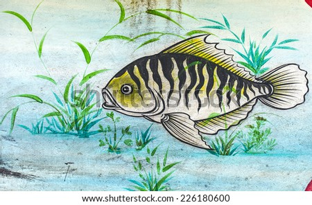 Fish painting on Chinese temple wall  - stock photo