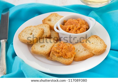 fish pate with mini toasts  with knife