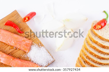 Fish, pepper and salt on a white background.