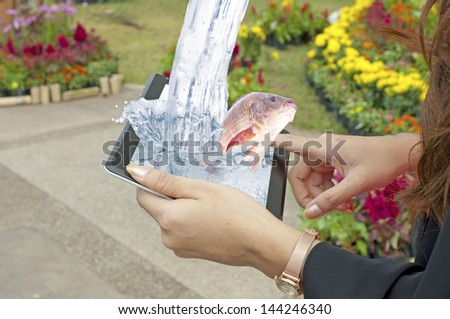 Fish reserved concept showing female hands... - stock photo