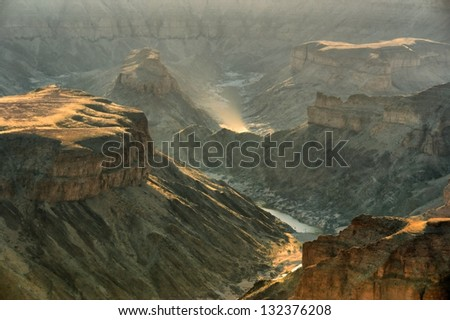 Fish River Canyon in sunset light. Shot in Namibia. - stock photo