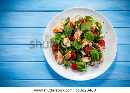 Fish salad - grilled salmon and vegetables  - stock photo