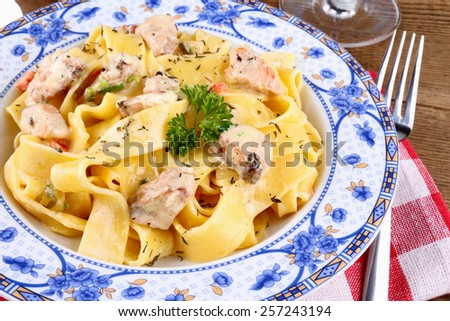 Fish salmon fillet with tagliatelle noodle, cream sauce - stock photo