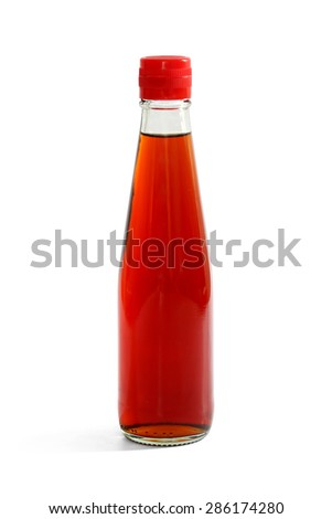 Fish sauce in glass bottle isolated on white background