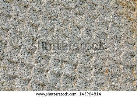Fish scale texture in stone carving - stock photo