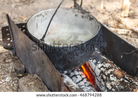 Fish soup on the fire. On open air
