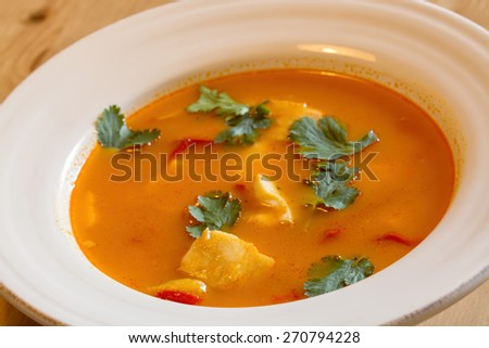 fish soup over wood table