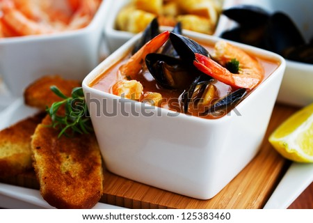 Fish soup - traditional Mediterranean fish soup with mussels and shrimp - stock photo