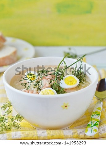 fish soup with  quail eggs in to the white bowl
