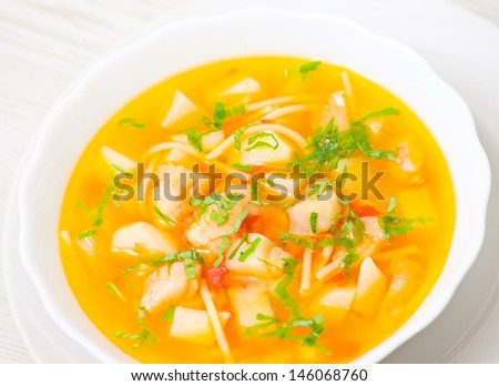 Fish soup with vegetables and pasta