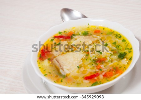 Fish soup with vegetables and rice