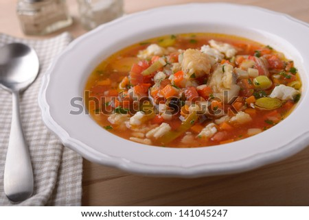 Fish soup with vegetables closeup