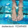 Fish spa in a beautiful blue water - stock photo