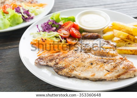 fish steak on wood table