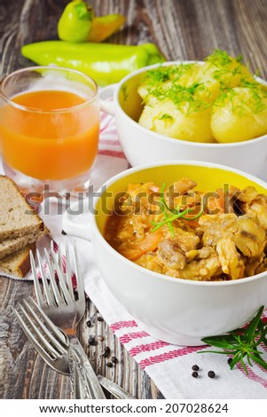 fish stew and boiled new potatoes in a bowl on the table. - stock photo