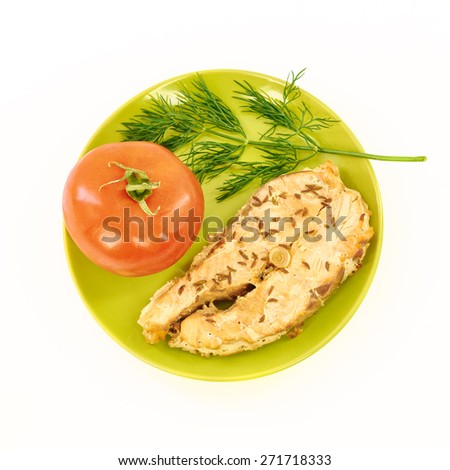 Fish stew and fresh vegetables on a white background