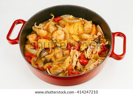 Fish stew wth seafood, paprika and onions isolated on white background - stock photo
