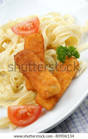 Fish sticks and home made noodles on a plate