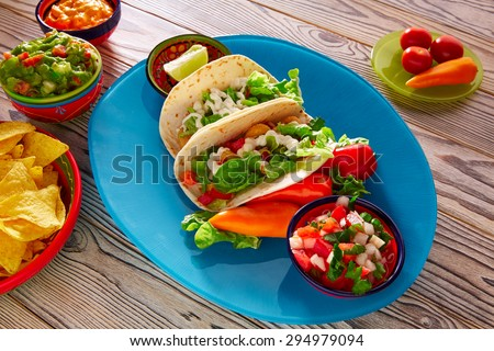 Fish tacos mexican food with guacamole nachos and chili pepper sauce ...