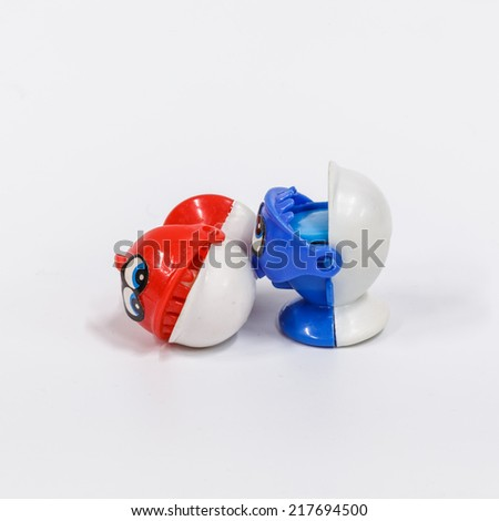 Fish toys on white background - stock photo