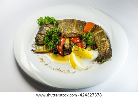 fish trout on the grill with vegetables - stock photo