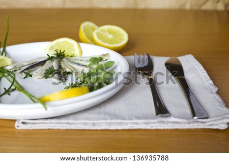 fish with aromatic herbs and lemon