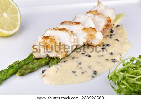Fish with asparagus - stock photo