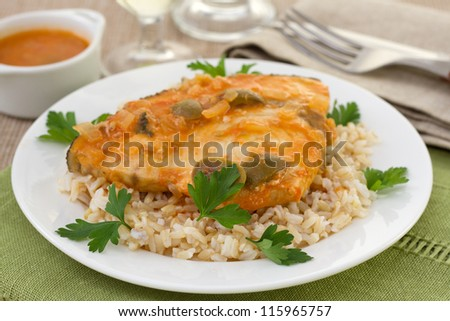 fish with boiled rice and glasses of wine and water