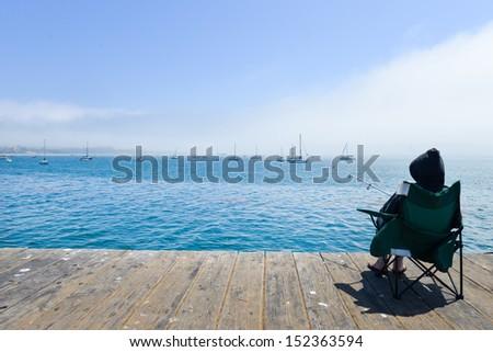 Old fisherman peaceful sunset vietnam stock photo for Deep sea fishing santa cruz