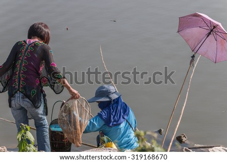 Fisheries or fisheries management means of human to catch fish or other aquatic animals. - stock photo