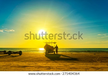 fisherman at work during great sunrise - stock photo