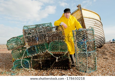 Fisherman At Work With Lobster Cages - stock photo