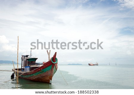 Fisherman boat against cloudy blue sky in Penang Malaysia - stock photo