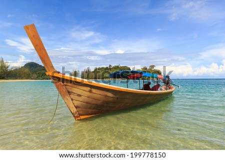 Fisherman boat float in blue sea with white sand beach and beautiful blue sky.Kangkao island.