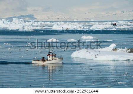 Fisherman boat, Greenland - stock photo