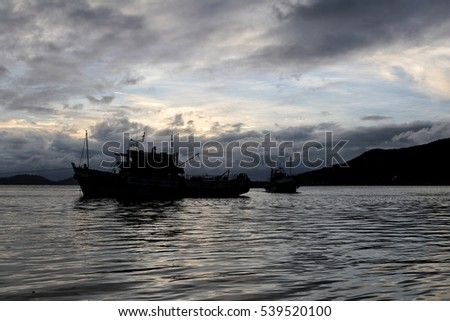 fisherman boat in songkhla lake thailand with sunset background