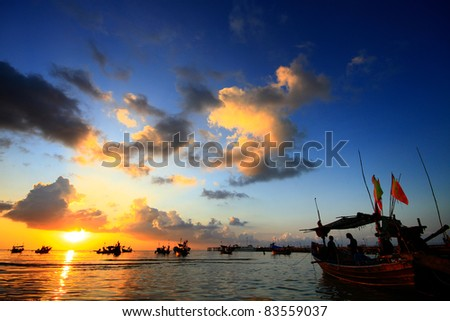 Fisherman Boat in sunset at Koh Samui, Thailand - stock photo