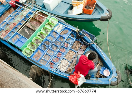 Fisherman boat with catch, Hong Kong