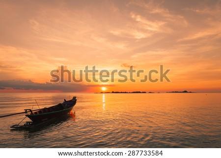Fisherman boat with sunset scene in koh phangan, Surat Thani, Thailand : selective focus on boat. - stock photo