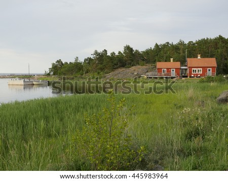 Fisherman cabin on the Swedish east coast in sunset - stock photo