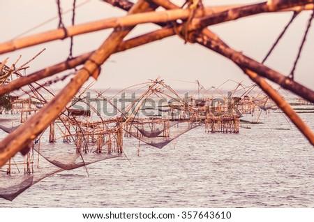 Fisherman Catching Fish From Fish lift net in Pak Pra Canel, Phatthalung - stock photo