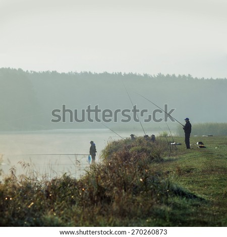 Fisherman fishing. A fisherman catches a fish in the morning