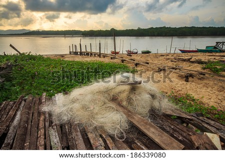 fisherman fishing nets on the wood with beautiful morning view. - stock photo