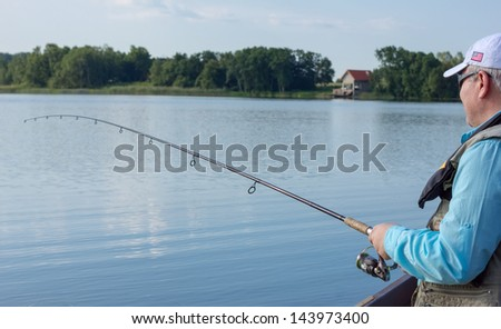 Fisherman fishing spinning - stock photo
