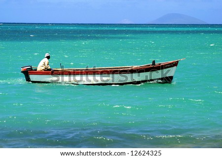 Fisherman in a boat (Mauritius)