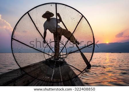 Fisherman in Inle Lake at sunset, Shan State, Myanmar. - stock photo