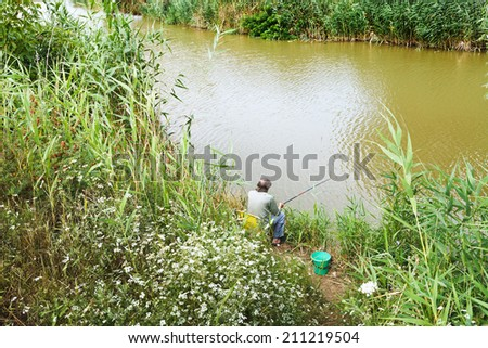 fisherman is fishing on riverbank, Kuban, Russia