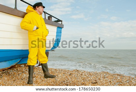 Fisherman Looking Out To Sea - stock photo